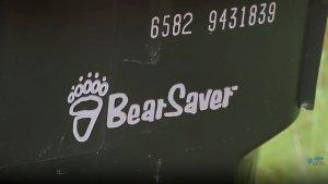 Swan Valley Bear video screenshot. Close-up of bear proof garbage bin.