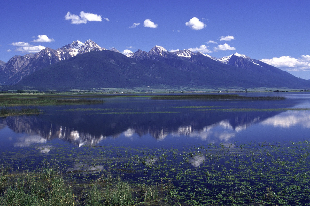 Kevin Rhoades photo of the Mission Mountains from Ninepipes Reservoir