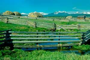 Fields with fences and mountains; Donate a conservation easement to Vital Ground