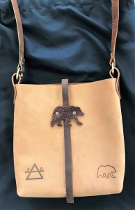 Grizzly bear tan leather crossbody bag with brown leather strap