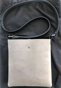 Grizzly bear grey leather crossbody bag with black leather strap from back