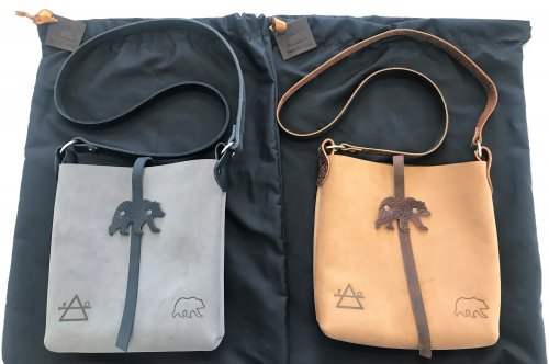Grizzly bear grey and tan leather crossbody bag with black leather strap and brown leather strap