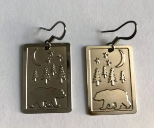 Grizzly bear earrings with nighttime forest scene, trees, stars, and moon
