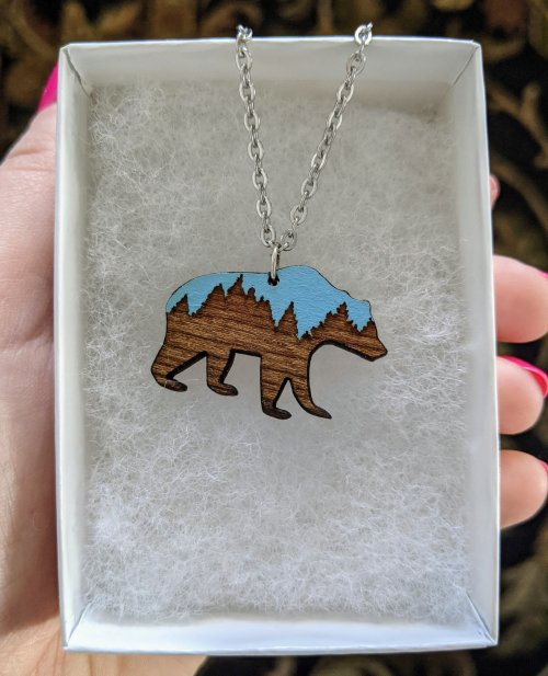 Necklace with wooden grizzly pendant