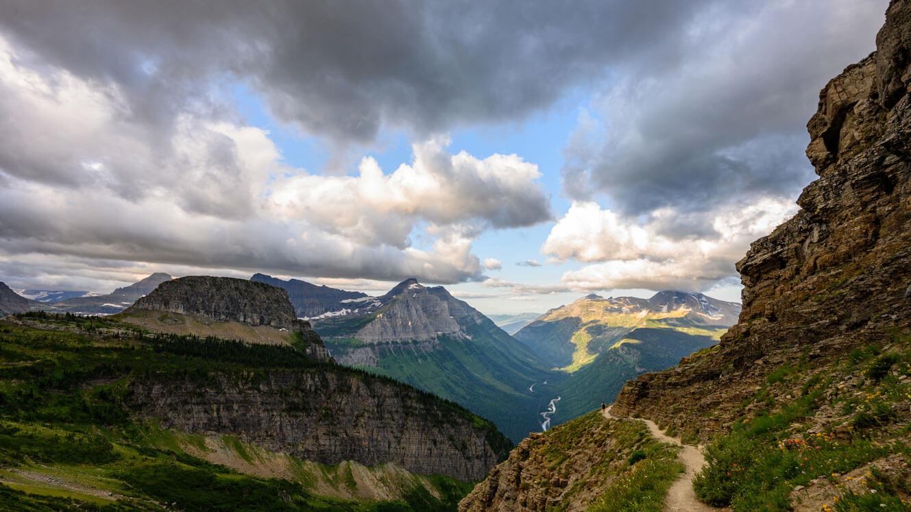 Hiker and landscape in Glacier National Park