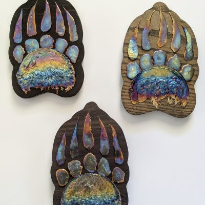 Three bismuth grizzly paws