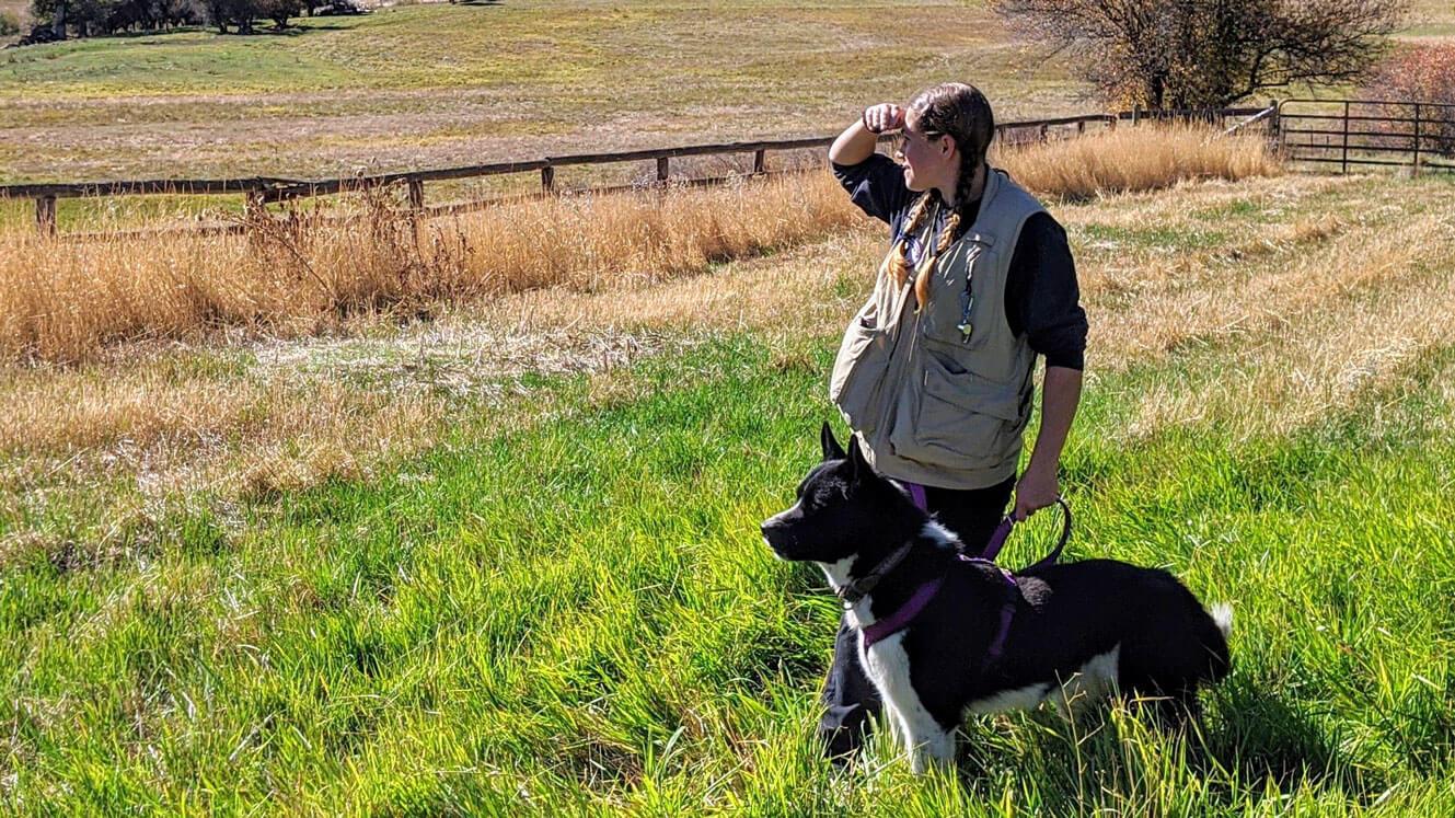 Wildlife service dog and biologist